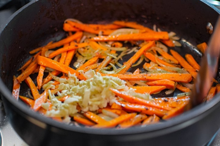 Fried carrots, onions and ginger in a pan