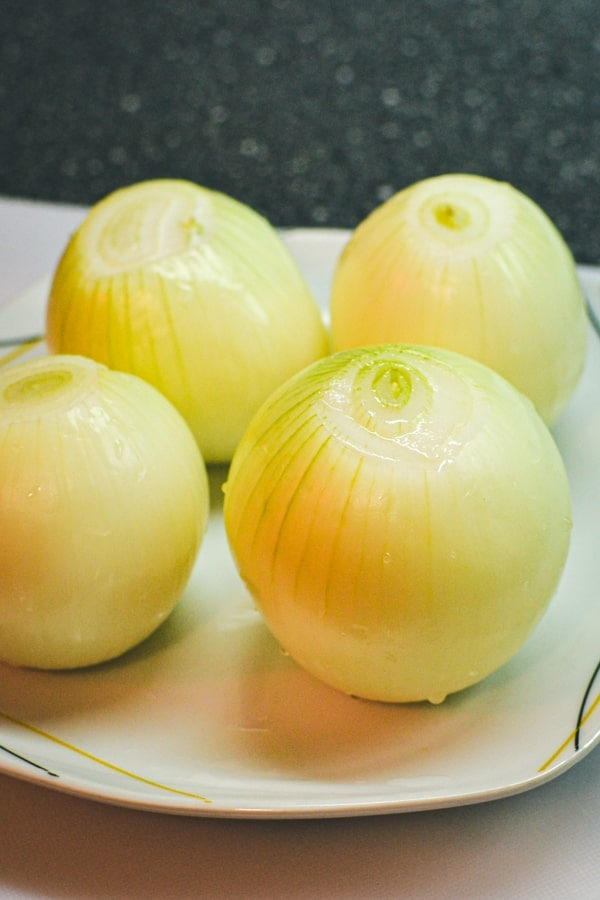 4 onions on a plate