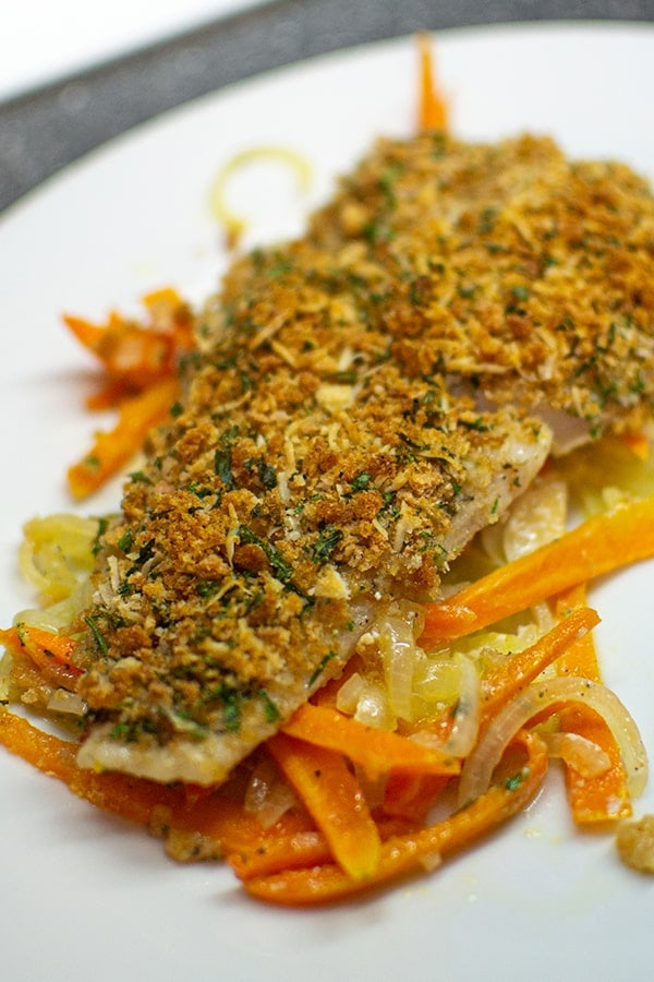 Delicious fish fillet with vegetables on plate