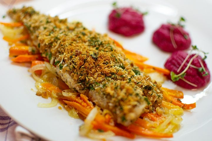 White fish fillet on plate with puree