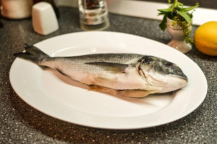Dorado Fish on a white plate