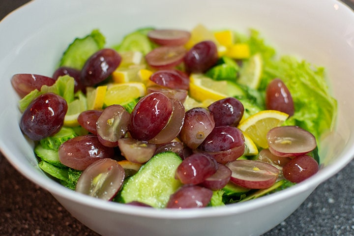 Summer salad of grapes, lemons, cucumbers and salad leafs