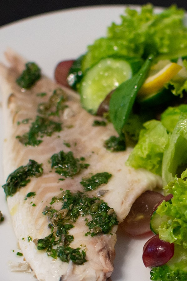 White fish fillet of a dorado fish with salad