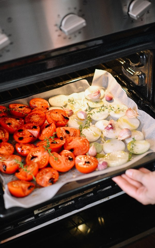 Inserting the tomatoes and onions into the oven