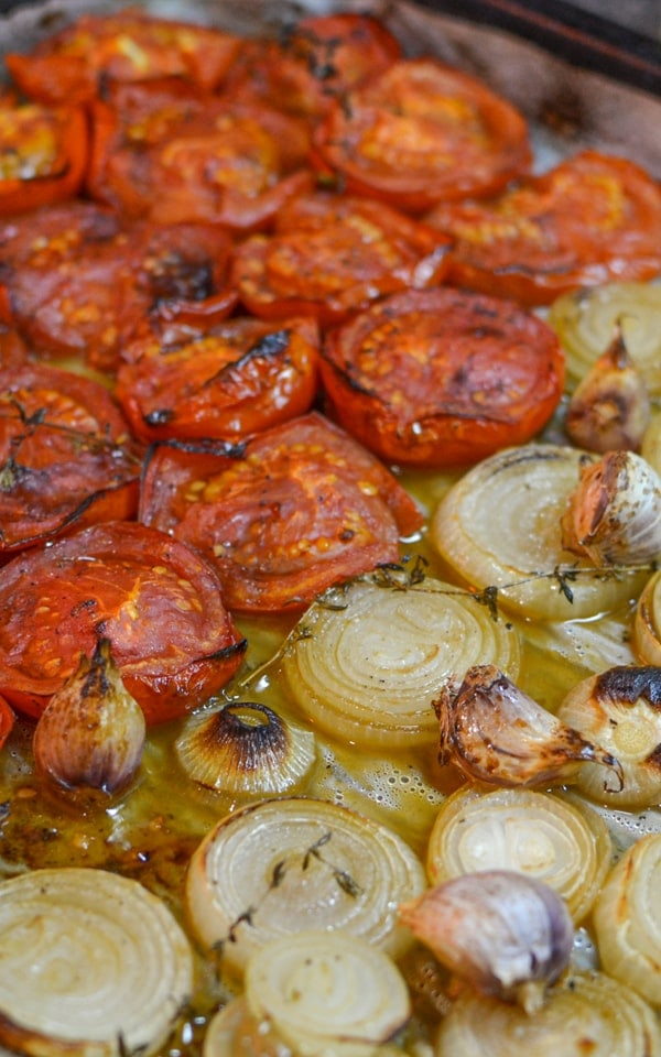 Baked tomatoes with baked onions and garlic