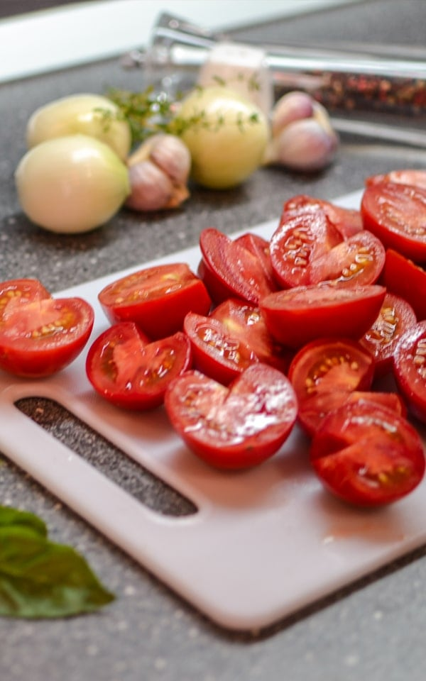 Slices of tomatoes with garlic and onions for a tomato soup