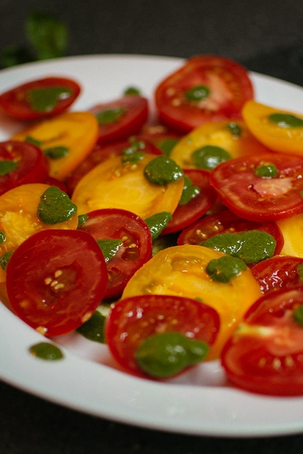 Red and yellow tomatoes with basil paste.