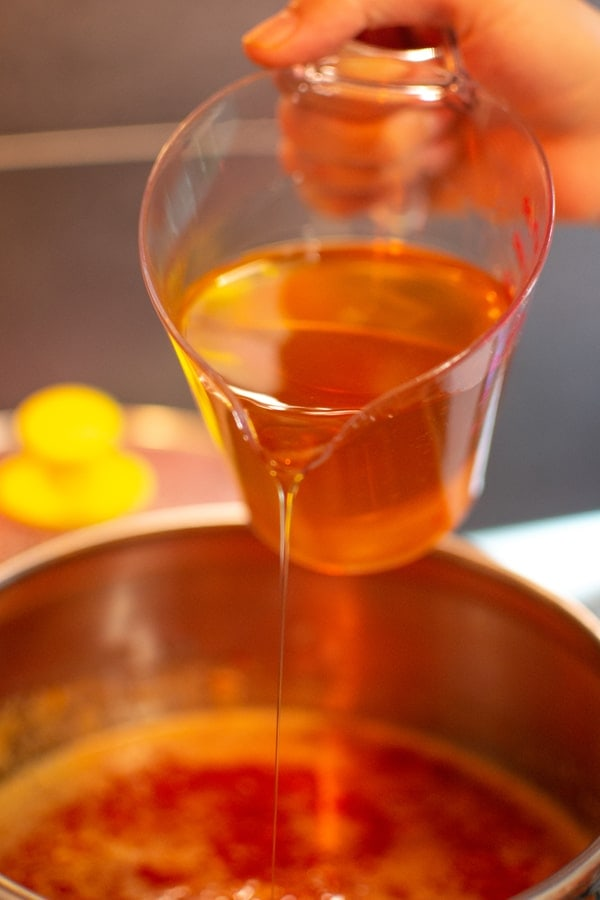 Flowing honey into the sweet chili sauce