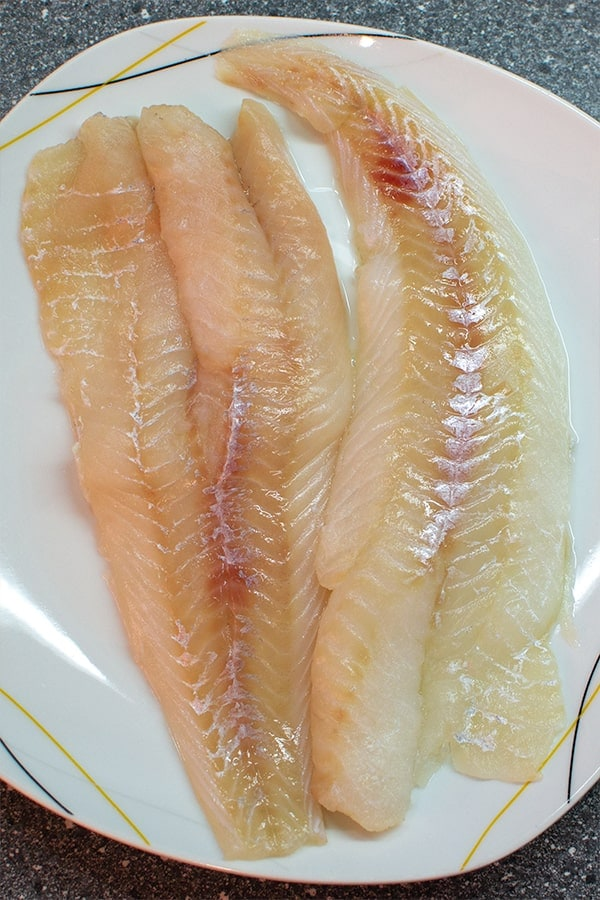 Raw fish fillet on plate
