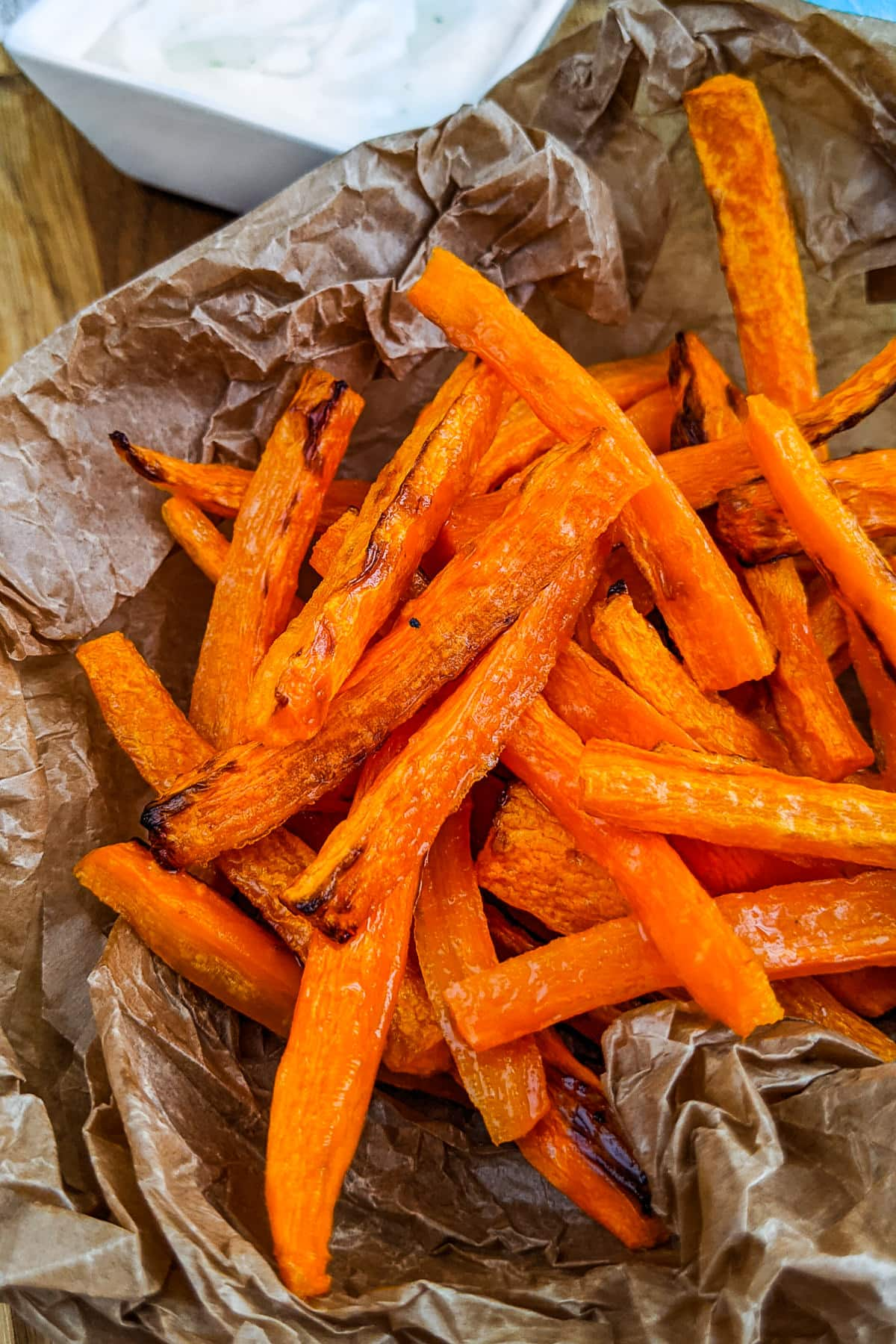 Carrot fries served on a parchment paper.
